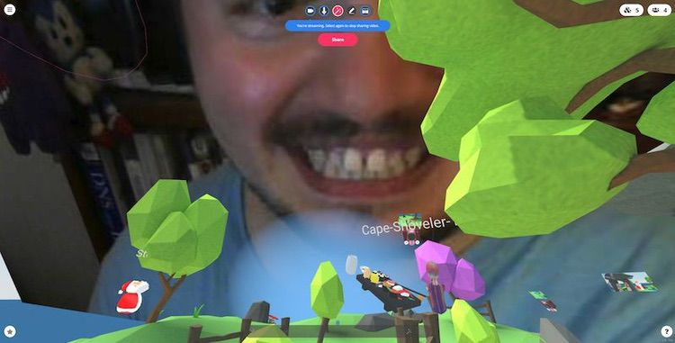 Screenshot of hubs with my face hovering in the sky, as someone's Santa Claus avatar watches my face